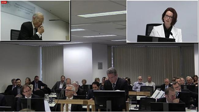 Julia Gillard faces a room of almost all men