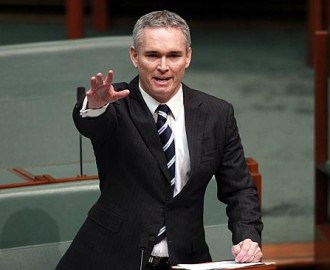 Thomson gestures towards the media during his address