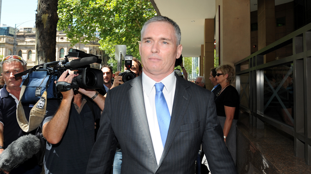 The long walk from court Photo - AAP