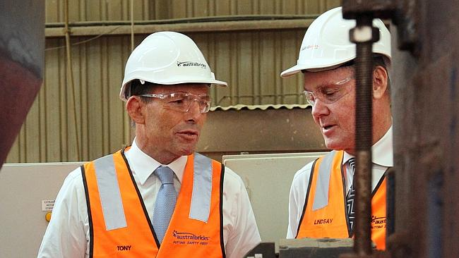 Abbott and Partridge ham it up for the press at the Brickworks factory Image - News Ltd