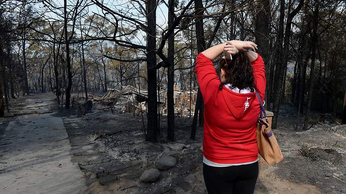Sorry about your home, but Baird's govt didn't want to have to pay firefighters overtime... Image - SBS