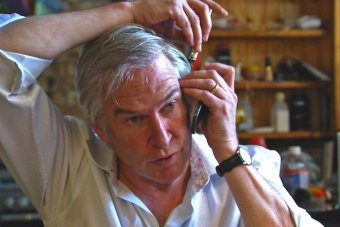 How not to address an itchy ear - Lawler demonstrates how monkeys use telephones Image - ABC