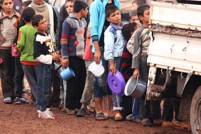 Syrian refugee children queue for food while Greens play politics in council