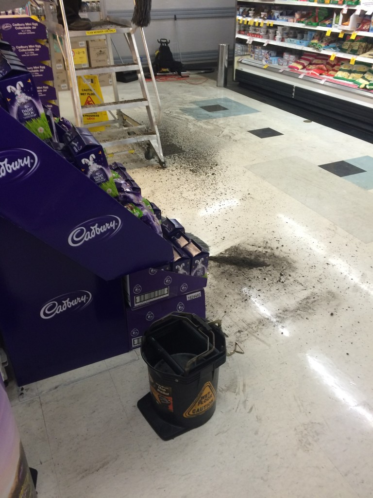 Piles of black dust on the floor for customers to walk through