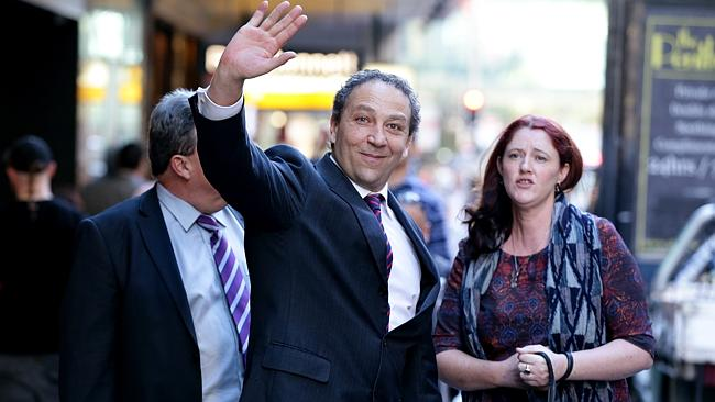 An incapacitated Bolano waves to QBE Insurance with Brehaut at his side Image - News Ltd