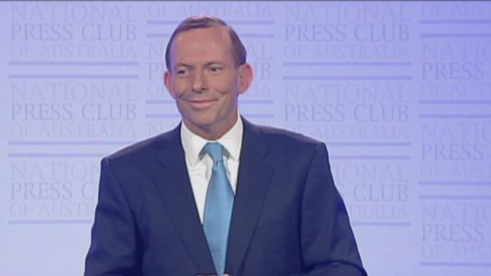 All going to plan - Abbott the moment he receives the signal from his staffer