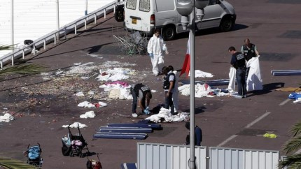 Authorities collect bodies on the road next to Nice Beach